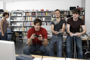 Colleagues playing video games at work